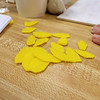 Members of the Fitchburg Senior Center made Mum Welcome Signs out of wood, paint and felt on Thursday at the center. Some yellow felt cut into petals for some sunflowers that they were making for the signs. SENTINEL & ENTERPRISE/JOHN LOVE