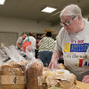 The Fitchburg Senior Center has a  meat, bread and pastry outreach program twice a week. Seniors or veterans can come in and get some food assistance if they need it. The food is donated by Hannaford Supermarket. Pam Chapman picks out some bread they had on Friday, August 2, 2019. SENTINEL & ENTERPRISE/JOHN LOVE