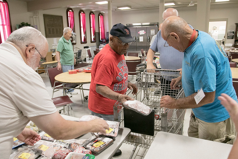 The Fitchburg Senior Center has a  meat, bread and pastry outreach program twice a week. Seniors or veterans can come in and get some food assistance if they need it. Volunteers put out the frozen meat as they get ready for the program on Friday August 2, 2019. SENTINEL & ENTERPRISE/JOHN LOVE