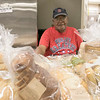 The Fitchburg Senior Center has a  meat, bread and pastry outreach program twice a week. Seniors or veterans can come in and get some food assistance if they need it. Volunteer Hiram Bones was ready to help anyone that need it at the bread table during the program Friday, August 2, 2019. SENTINEL & ENTERPRISE/JOHN LOVE