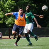 Alum Danny Bolam and Fitchburg State's Marck Bastein chase down the ball during the Fitchburg State alumni soccer game on Saturday afternoon, with current players facing off against alumni. SENTINEL & ENTERPRISE / Ashley Green