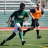 Marck Bastein chases down the ball during the Fitchburg State alumni soccer game on Saturday afternoon, with current players facing off against alumni. SENTINEL & ENTERPRISE / Ashley Green