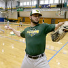 Fitchburg State University baseball centerfielder junior Drew Mazzeofrom Leicester throws the ball around to end practice on Wednesday February 15, 2017. SENTINEL & ENTERPRISE/JOHN LOVE