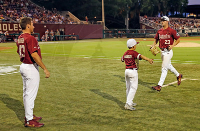Reese Albert greeted as he comes off the field