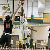 Fitchburg State University basketball played Clark University on Wednesday night, Nov. 13, 2019. CU's #21 Zackary Mittlelstadt tries to stop a shot by FSU's #24 Nicholas Tracy. SENTINEL & ENTERPRISE/JOHN LOVE