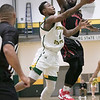 Fitchburg State University basketball played Clark University on Wednesday night, Nov. 13, 2019. FSU's #4 Devon Johnson tries to a shot by CU's #4 Biko Gayman. SENTINEL & ENTERPRISE/JOHN LOVE