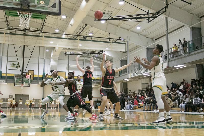 Fitchburg State University basketball played Clark University on Wednesday night, Nov. 13, 2019. FSU's #4 Devon Johnson tries to inbound a pass to his teammate #24 Nicholas Tracy. SENTINEL & ENTERPRISE/JOHN LOVE