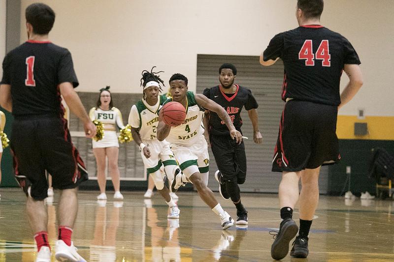 Fitchburg State University basketball played Clark University on Wednesday night, Nov. 13, 2019. FSU's #4 Devon Johnson brings the ball up court. SENTINEL & ENTERPRISE/JOHN LOVE