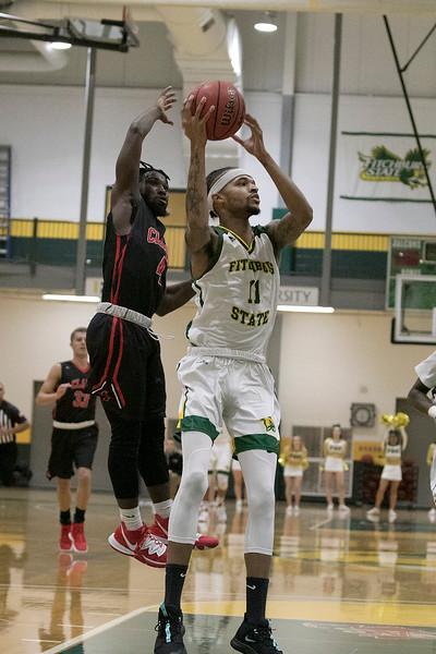Fitchburg State University basketball played Clark University on Wednesday night, Nov. 13, 2019. CU's #$ Biko Gayman tries to strip the ball away from FSU's #11 Jordan Jones. SENTINEL & ENTERPRISE/JOHN LOVE