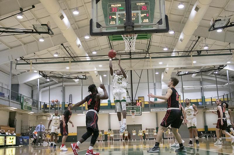 Fitchburg State University basketball played Clark University on Wednesday night, Nov. 13, 2019. FSU's #24 Nicholas Tracy puts up a shot. SENTINEL & ENTERPRISE/JOHN LOVE