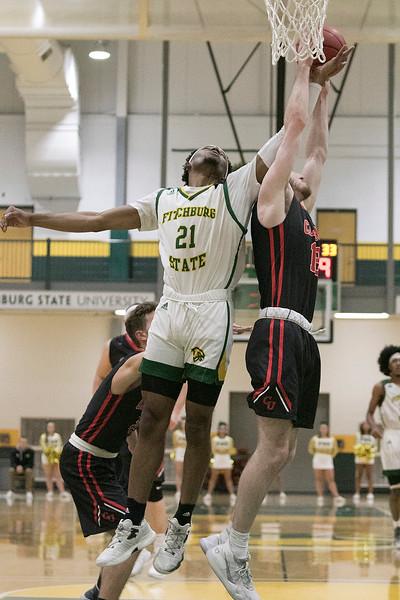 Fitchburg State University basketball played Clark University on Wednesday night, Nov. 13, 2019. FSU's #21 Tayjaun McKenzie and CU's #12 Sean Christy fight for a rebound. SENTINEL & ENTERPRISE/JOHN LOVE