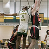 Fitchburg State University basketball played Clark University on Wednesday night, Nov. 13, 2019. FSU's #21 Tayjaun McKenzie and CU's #12 Sean Christy fight for a rebound. SENTINEL & ENTERPRISE/JOHN LOVE