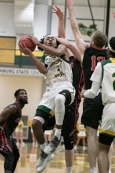 Fitchburg State University basketball played Clark University on Wednesday night, Nov. 13, 2019. FSU's #22 Dominik Williams is fouled while going up for a shot. SENTINEL & ENTERPRISE/JOHN LOVE