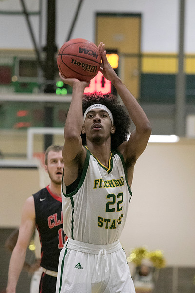 Fitchburg State University basketball played Clark University on Wednesday night, Nov. 13, 2019. FSU's #22 Dominik Williams makes a free throw. SENTINEL & ENTERPRISE/JOHN LOVE