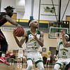 Fitchburg State University basketball played Clark University on Wednesday night, Nov. 13, 2019. CU's #$ Biko Gayman tries to strip the ball away from FSU's #11 Jordan Jones. SENTINEL & ENTERPRISE/JOHN LOVE