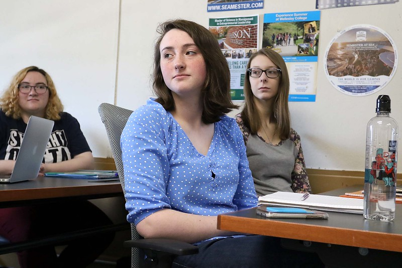 Fitchburg State University Sophomore Caroline anderson, 19, from Lunenburg listens to fellow classmates talk about the survey they did on what people thought of Fitchburg in their Current Events and Service Learning class with Assistant Professor of Ecomonics Christa Marr on Tuesday, May 1, 2018. Right behind her is freshman Brooke Pelletier from Salisbury, SENTINEL & ENTERPRISE/JOHN LOVE