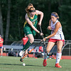 Fitchburg State University field hockey played New England College on Friday, August 30, 2019 at Elliot Field in Fitchburg. FSU's Grace Kerr jumps over the stick of NEC's Renee Bouchard during action in the game. SENTINEL & ENTERPRISE/JOHN LOVE