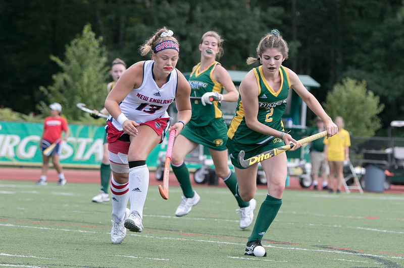 Fitchburg State University field hockey played New England College on Friday, August 30, 2019 at Elliot Field in Fitchburg. FSU's Sarah Craig and NEC's Giuliana Kevlin chase after a loose ball. SENTINEL & ENTERPRISE/JOHN LOVE