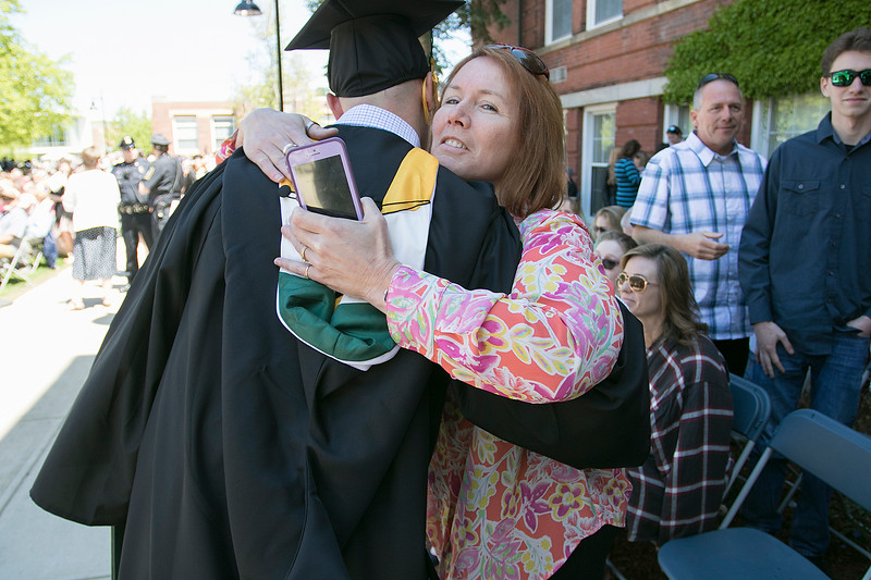 The 123rd Commencement ceremony for Undergraduates was held at Fitchburg State University on Saturday, May 18, 2019. Kerry Cooper of Shirley gives graduate Adam Hyde of Shirley a hug after he got his diploma during the ceremony. SENTINEL & ENTERPRISE/JOHN LOVE
