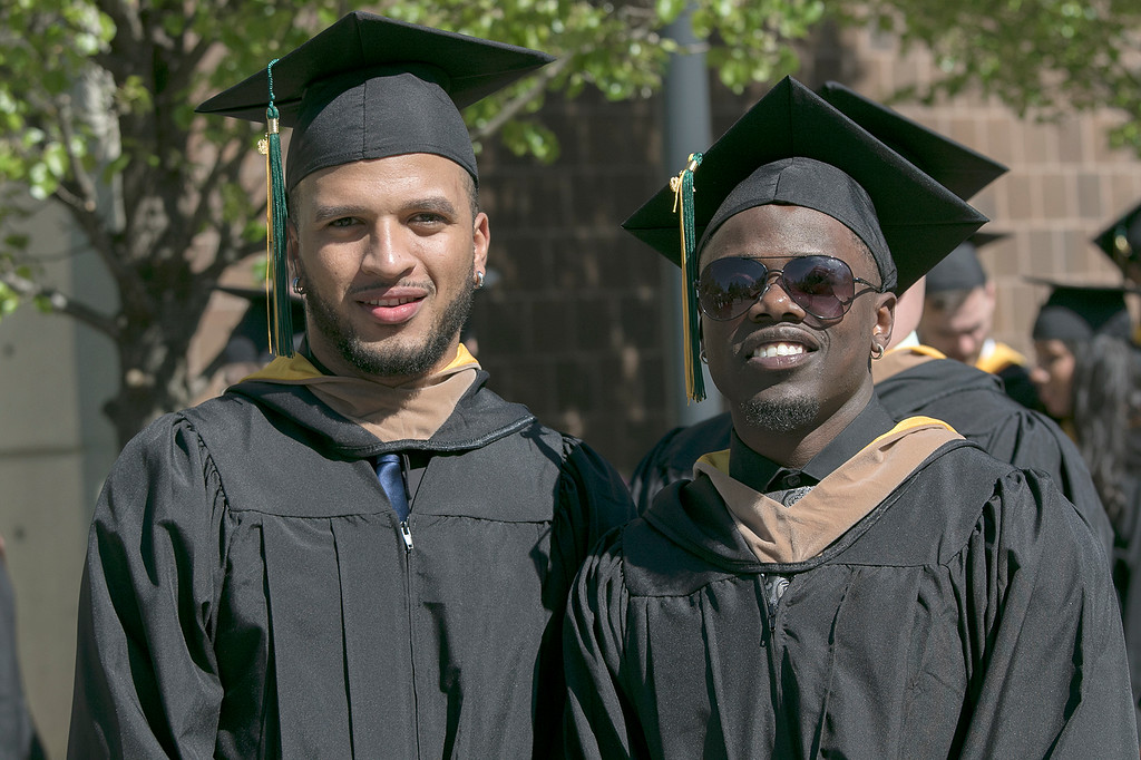 . The 123rd Commencement ceremony for Undergraduates was held at Fitchburg State University on Saturday, May 18, 2019. Nelson Valerio of Lawrence and Christopher Tamukedde from Lowell posed for a picture as they waited for the ceremony to start. SENTINEL & ENTERPRISE/JOHN LOVE