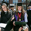 The 123rd Commencement ceremony for Undergraduates was held at Fitchburg State University on Saturday, May 18, 2019. Graduates Courtney Meneely, on left, from Fitchburg and Demetra Zouzas from Chelmsford look at their diplomas during the ceremony. Sitting next to them, on right, is John Pino from Quincy. SENTINEL & ENTERPRISE/JOHN LOVE