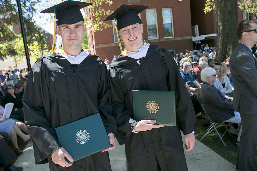 . The 123rd Commencement ceremony for Undergraduates was held at Fitchburg State University on Saturday, May 18, 2019. Graduates Andrew Gower, on left, from Ayer and Adam Hyde from Shirley just got their diplomas at the ceremony. SENTINEL & ENTERPRISE/JOHN LOVE