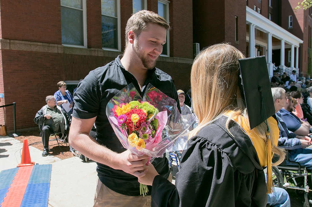 . The 123rd Commencement ceremony for Undergraduates was held at Fitchburg State University on Saturday, May 18, 2019. Andrew Pierce of Gardner gives his girlfriend Jerrika St. John of Gardner some flowers after she got her diploma during the ceremony. SENTINEL & ENTERPRISE/JOHN LOVE