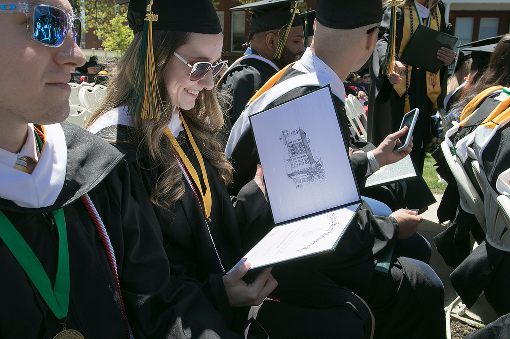 . The 123rd Commencement ceremony for Undergraduates was held at Fitchburg State University on Saturday, May 18, 2019. Graduate Daniela Rose Wholey From Fitchburg takes a look at her diploma during the ceremony. SENTINEL & ENTERPRISE/JOHN LOVE