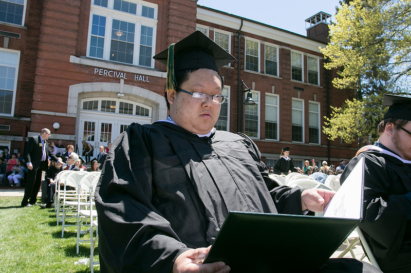 The 123rd Commencement ceremony for Undergraduates was held at Fitchburg State University on Saturday, May 18, 2019. Graduate Torrey Wang of Lancaster looks over his diploma during the ceremony. SENTINEL & ENTERPRISE/JOHN LOVE