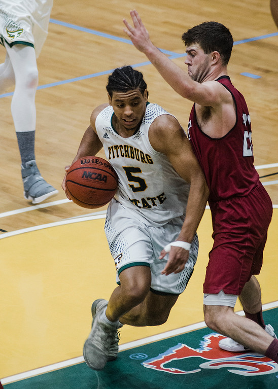 . Fitchburg State\'s Jonathan Perez in action during the game against MIT on Saturday, December 9, 2017. SENTINEL & ENTERPRISE / Ashley Green