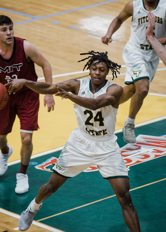 . Fitchburg State\'s Nicholas Tracy in action during the game against MIT on Saturday, December 9, 2017. SENTINEL & ENTERPRISE / Ashley Green