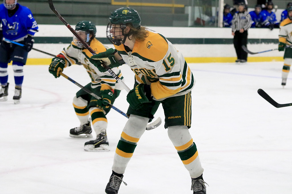 . Fitchburg State University men\'s hockey played Westfield State University on Saturday, February 16, 2019 at FSU\'s Wallace Civic Center. FSU\'s Ryan Murphy watches his shot on goal. It was their first score of the game in the first period. SENTINEL & ENERPRISE/JOHN LOVE