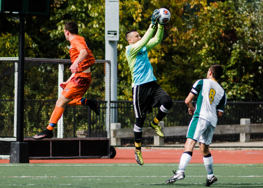 . Fitchburg State goalkeeper Alex Al-Zaibak makes a save during the game against Salem State on Saturday, October 7, 2017. SENTINEL & ENTERPRISE / Ashley Green