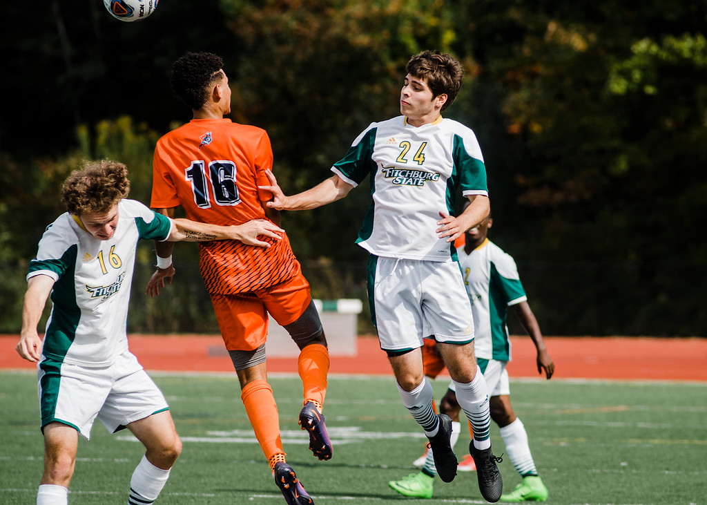 . Fitchburg State\'s Daniel Wotton and Felipe Martins-Ferreira in action during the game against Salem State on Saturday, October 7, 2017. SENTINEL & ENTERPRISE / Ashley Green