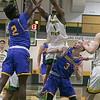 Fichtburg State University men's basketball played Worcester State University Saturday, Jan. 25, 2020 in Fitchburg at the FSU Recreation Center. FSU's #4 Devon Johnson reaches for a rebound with WSU's #2 Corey Olivier. SENTINEL & ENTERPRISE/JOHN LOVE