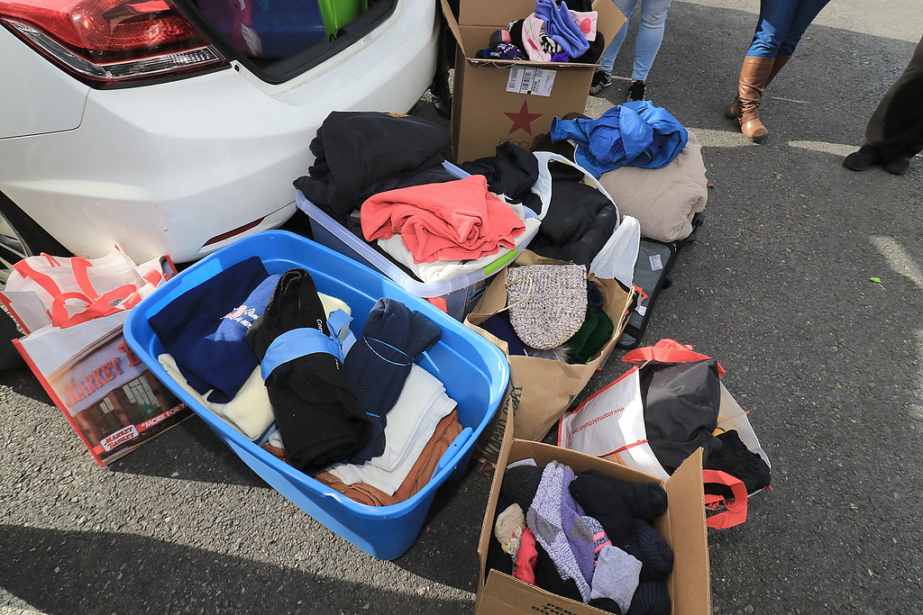. Nursing students from Fitchburg State University where in the parking lot behind Rye & Thyme in Leominster handing out clothing to the homeless on Thursday afternoon. Some of the boxes of clothing they had for the homeless. SENTINEL & ENTERPRISE/JOHN LOVE