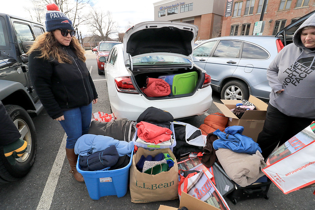 . Nursing students from Fitchburg State University where in the parking lot behind Rye & Thyme in Leominster handing out clothing to the homeless on Thursday afternoon. Senior Keri Joyce, on left, satnds over some of the clothes that they had to give to the homeless. SENTINEL & ENTERPRISE/JOHN OVE