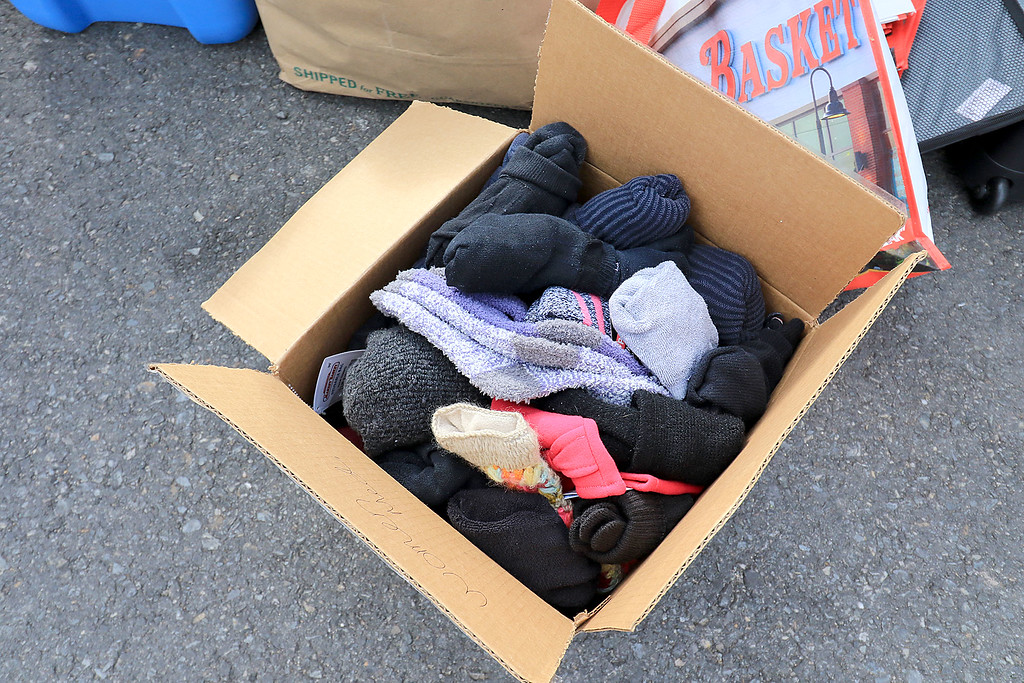 . Nursing students from Fitchburg State University where in the parking lot behind Rye & Thyme in Leominster handing out clothing to the homeless on Thursday afternoon. Some of the socks they had for the homeless. SENTINEL & ENTERPRISE/JOHN OVE