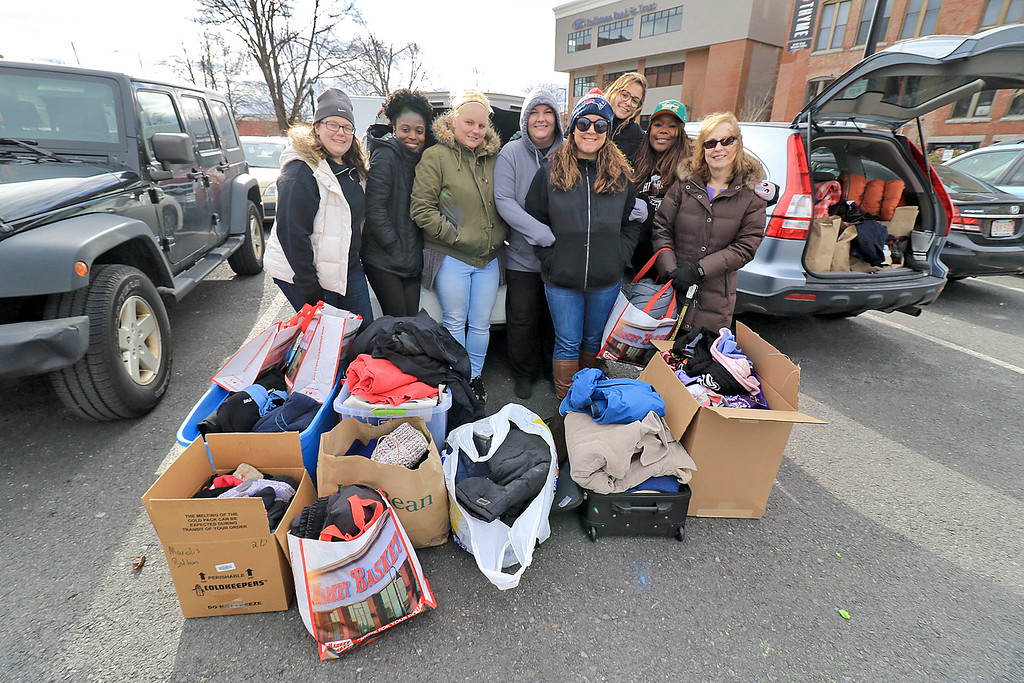 . Nursing students from Fitchburg State University where in the parking lot behind Rye & Thyme in Leominster handing out clothing to the homeless on Thursday afternoon. From left is senior students, Catherine Brennan, Rachel Danso, Krysten Ross, Melissa Rodrigues, Keri Joyce, Jordan Ayotte, Grace Menturi and their advisor Tara Mariolis. SENTINEL & ENTERPRISE/JOHN LOVE