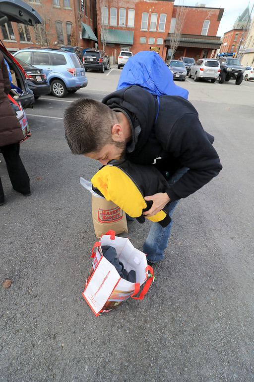 . Nursing students from Fitchburg State University where in the parking lot behind Rye & Thyme in Leominster handing out clothing to the homeless on Thursday afternoon. William Cardoso packs up some stuff he got for his girl friend who was homeless. SENTINEL & ENTERPRISE/JOHN OVE