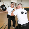 Fitchburg State Police Academy at the McKay building, July 20, 2019.  They had a family orientation day to let the family's of the cadets in on what is going on during their training. Cadets Jayson Urato of Leominster and Adam Hyde of Shirley run through a drill as members of their family watch. SENTINEL & ENTERPRISE/JOHN LOVE