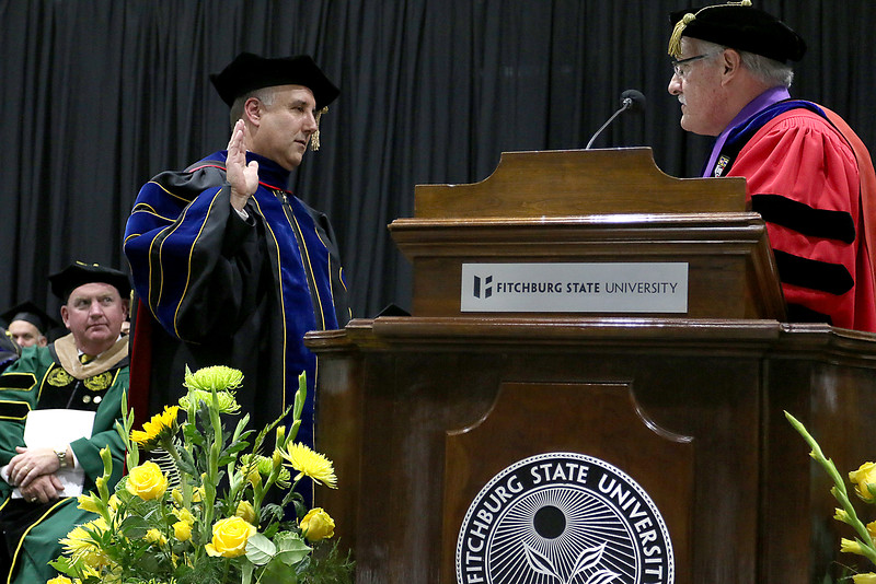 Richard S. Lapidus is sworn in as the 11th president of Fitchburg State University by Commissioner of the Board of Higher Education Dr. Carlos E. Santiago during the inauguration ceremony on Thursday afternoon at the Athletics & Recreation Center on the campus. SENTINEL & ENTERPRISE/JOHN LOVE