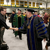 Fitchburg State University Sophomore Jay Reiss, 20, from Northbridge shakes hands with the new President Richard S. Lapidus after the inauguration ceremony that made him the 11th president of the University on Thursday afternoon at the Athletics & Recreation Center on the campus. SENTINEL & ENTERPRISE/JOHN LOVE