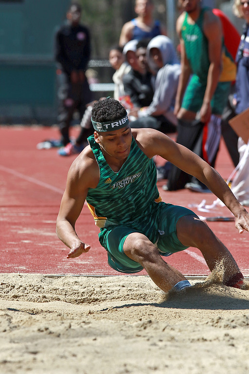 . Fitchburg State University track on April 6, 2019. Competing in the triple jump is FSU\'s Brandon McNeil from Dartmouth. SENTINEL & ENTERPRISE/JOHN LOVE