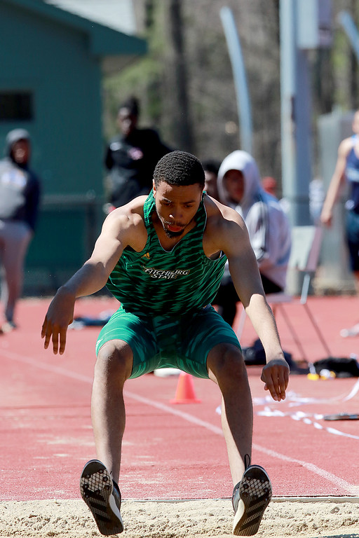 . Fitchburg State University track on April 6, 2019. Competing in the triple jump is FSU\'s Wilkerson Pierre from Cambridge MA. SENTINEL & ENTERPRISE/JOHN LOVE