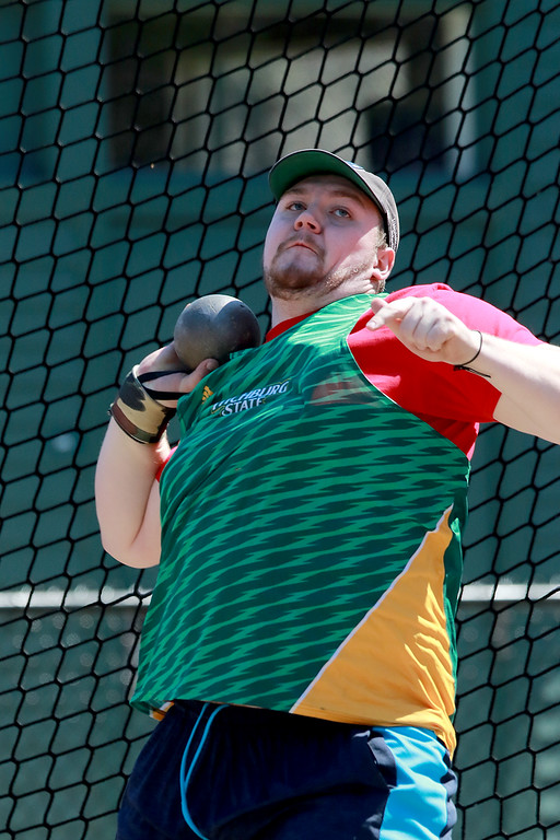 . Fitchburg State University track on April 6, 2019. Competing in the shot put is FSU\'s Brendan Courtney from North Attleboro. SENTINEL & ENTERPRISE/JOHN LOVE
