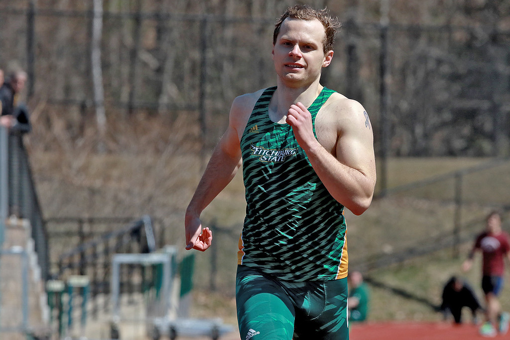 . Fitchburg State University track on April 6, 2019. Competeing in the 400 meter race is FSU\'s Ryan Carter Leominster. SENTINEL & ENTERPRISE/JOHN LOVE
