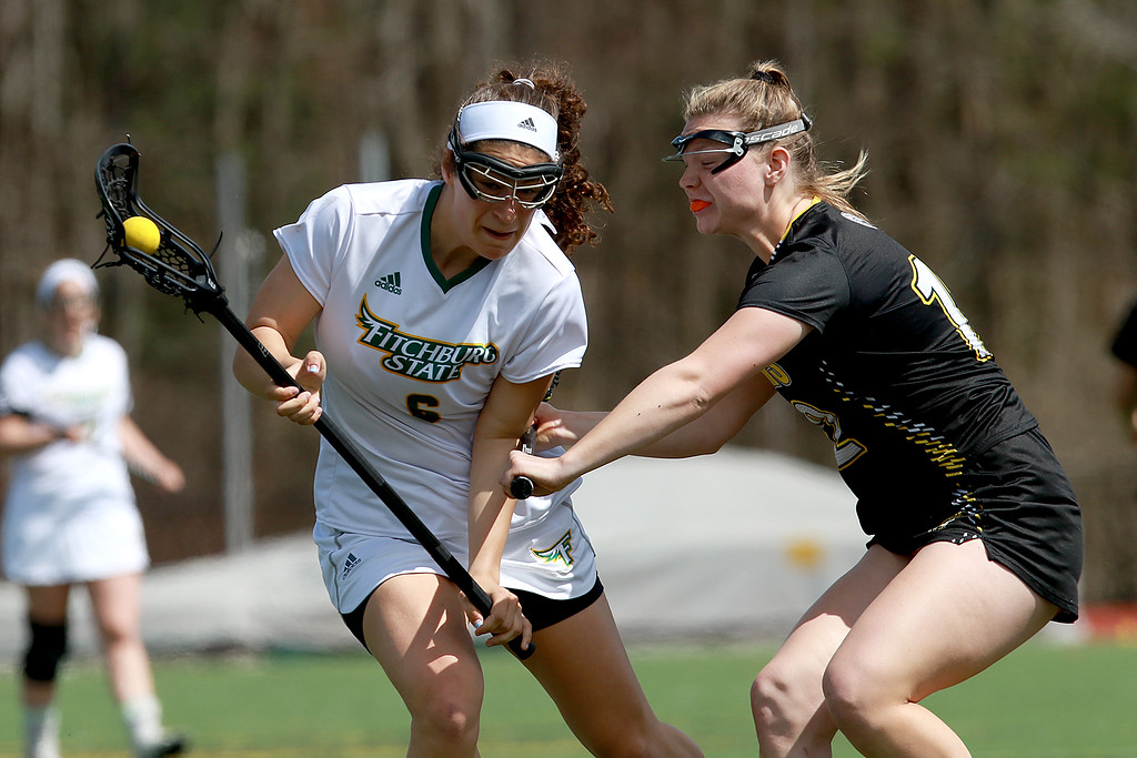 . Fitchburg State University women\'s lacrosse played Framingham State University on Saturday afternoon at FSU\'s Elliot Field Athletic Complex in Fitchburg. Fitchburg\'s Riley Hess gets checked by Framingham\'s Hailey Davis. during action in the game. SENTINEL & ENTERPRISE/JOHN LOVE