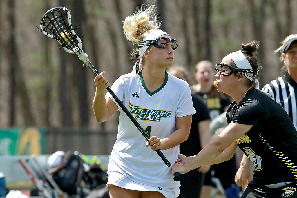 . Fitchburg State 7women\'s lacrosse played Framingham State University on Saturday afternoon at FSU\'s Elliot Field Athletic Complex in Fitchburg. Fitchburg\'s Sarah Napolitano tries to hold onto the ball as she is covered by Framingham\'s Casey Bradley during action in the game. Framingham State won, 15-5. SENTINEL & ENTERPRISE/JOHN LOVE