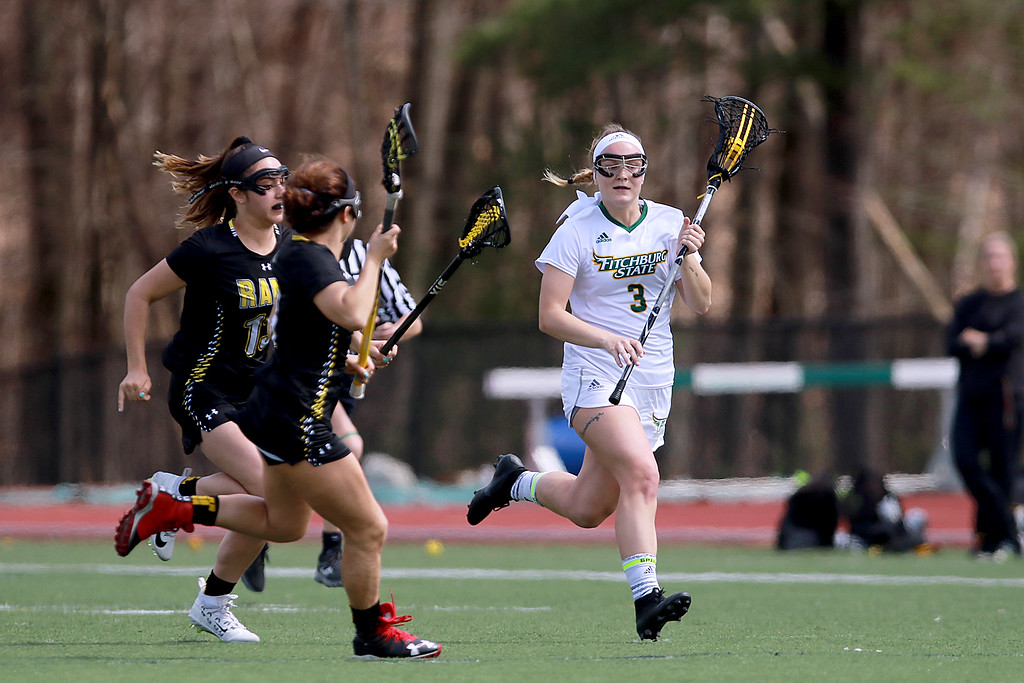 . Fitchburg State University women\'s lacrosse played Framingham State University on Saturday afternoon at FSU\'s Elliot Field Athletic Complex in Fitchburg. Fitchburg\'s Nicole Kopacz runs down field with the ball during action in the game. SENTINEL & ENTERPRISE/JOHN LOVE